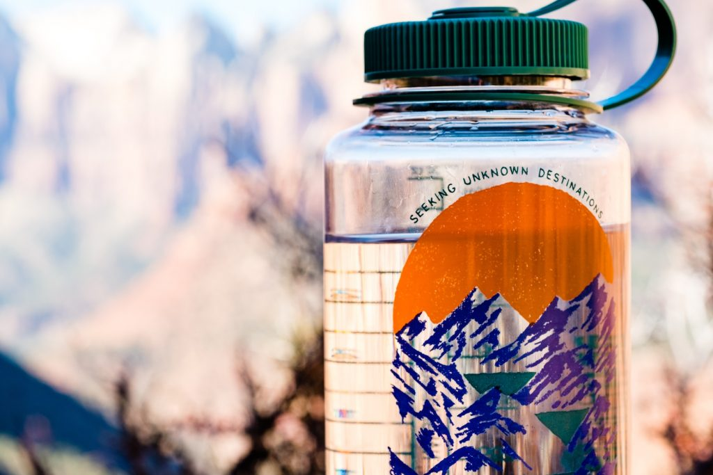 A reusable water bottle with a wide lid is perfect to use with a water purifier on the road.