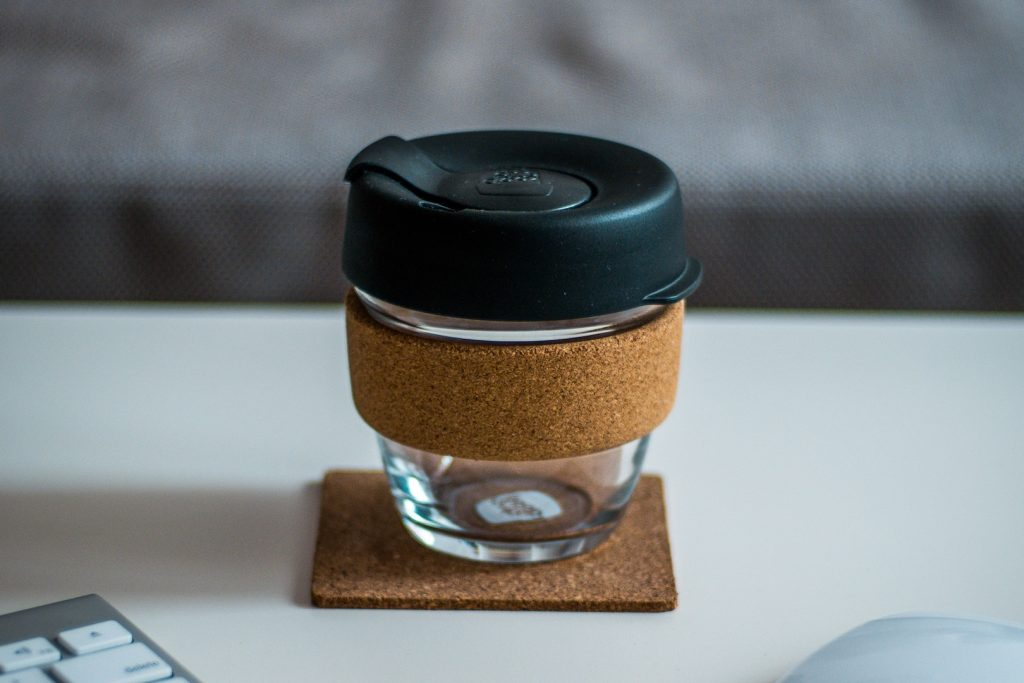 A reusable coffee cup is the first step to be a greener traveller.