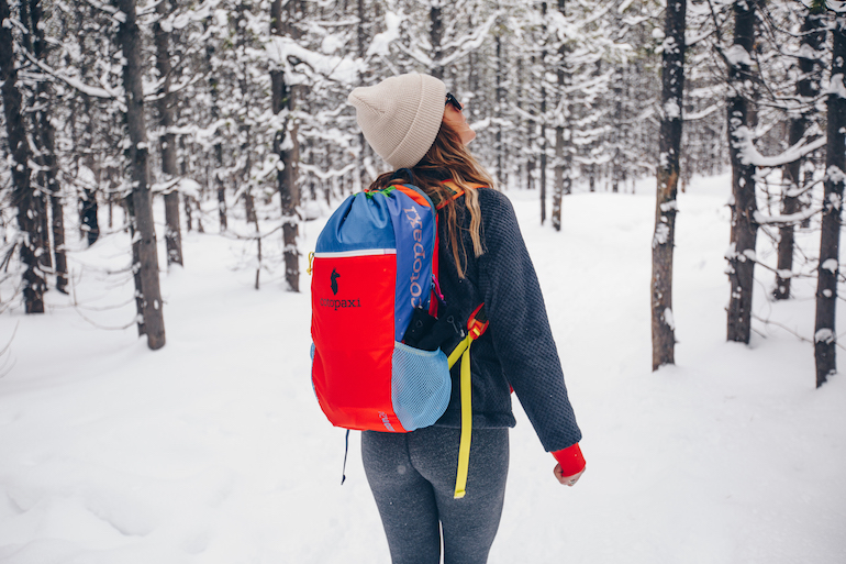 Girl wearing a Cotopaxi backpack
